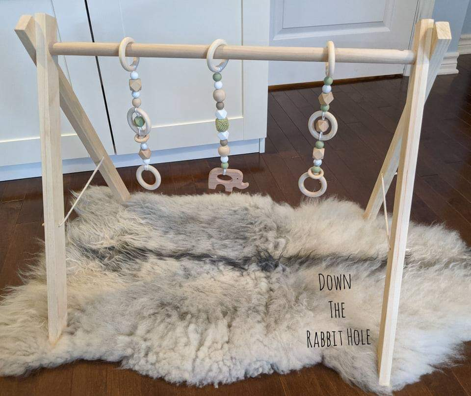 Down the Rabbit Hole Wooden Play Gym with 3 playstrings